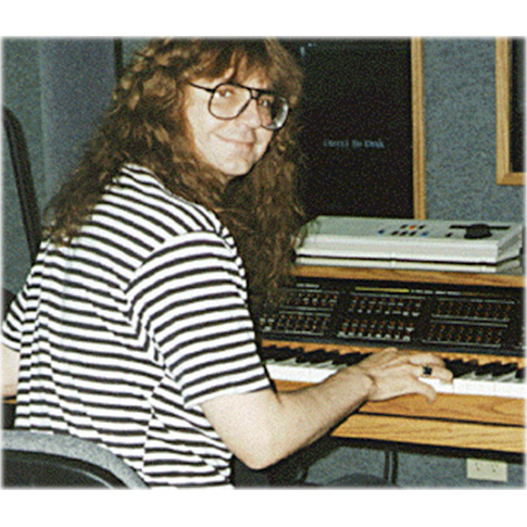 Christopher Currell with his Synclavier® Digital Audio System, late 1980s